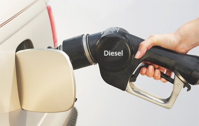 diesel fuel hand holding pump nozzle in car
