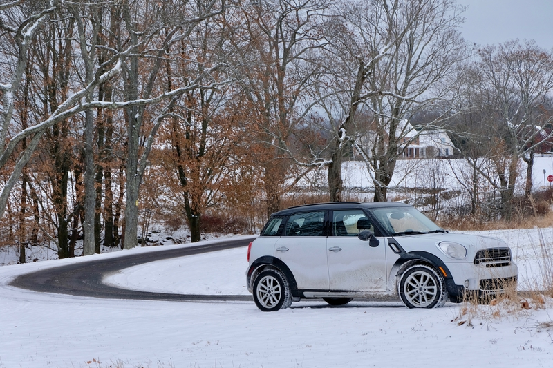 mini car driving on snowy road