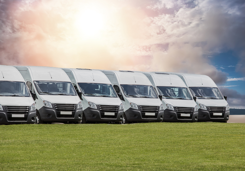minibuses on the grass field