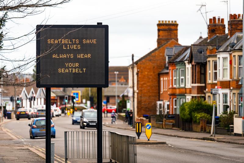 "UK digital road sign saying ""Seat belts save lives. Always wear your seat belt."""