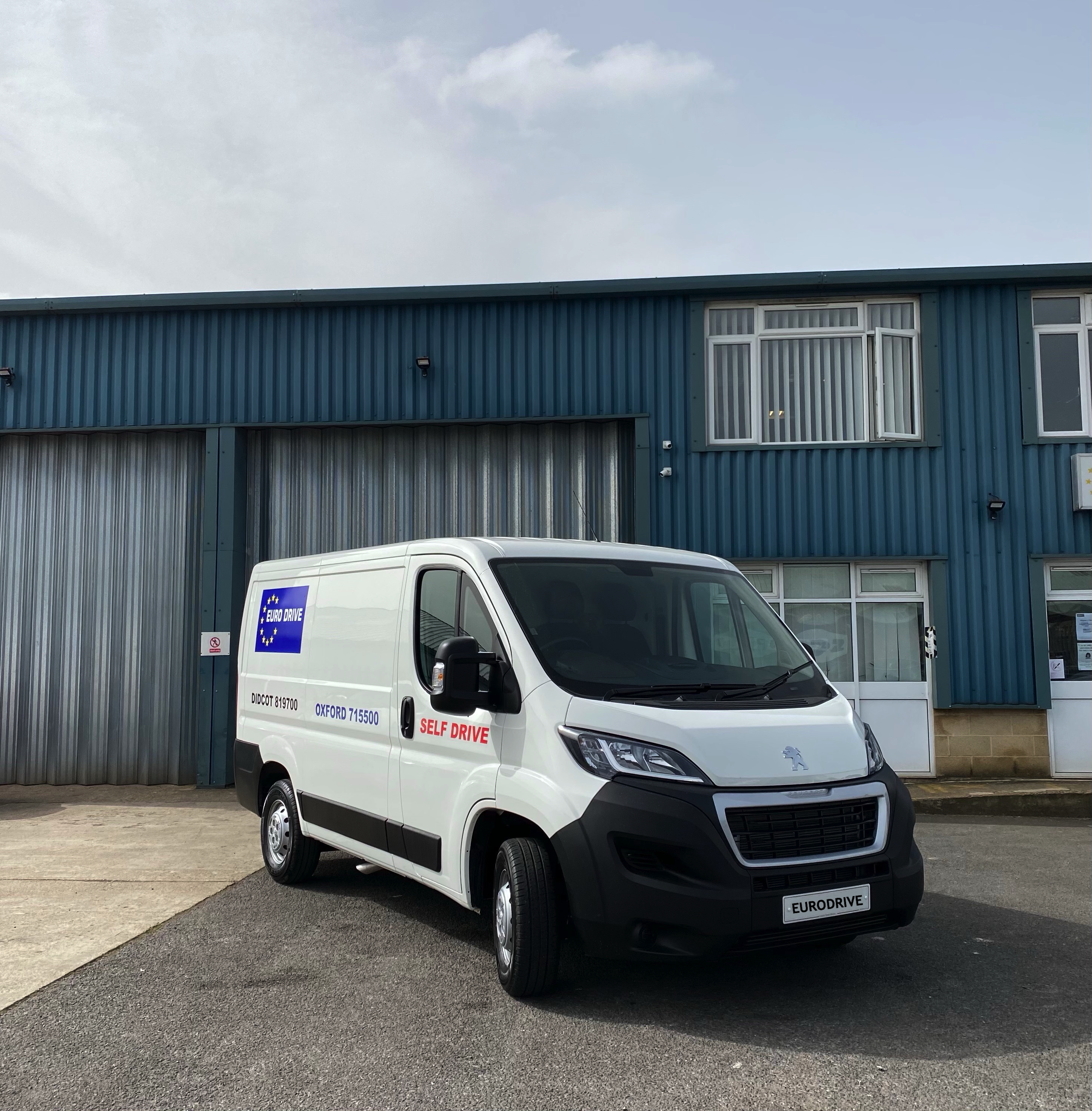 a white Peugeot van available for hire from EuroDrive